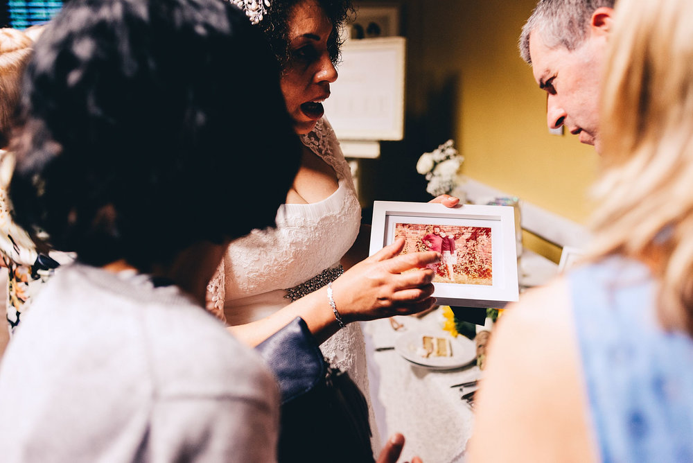Bride shows off her family photos
