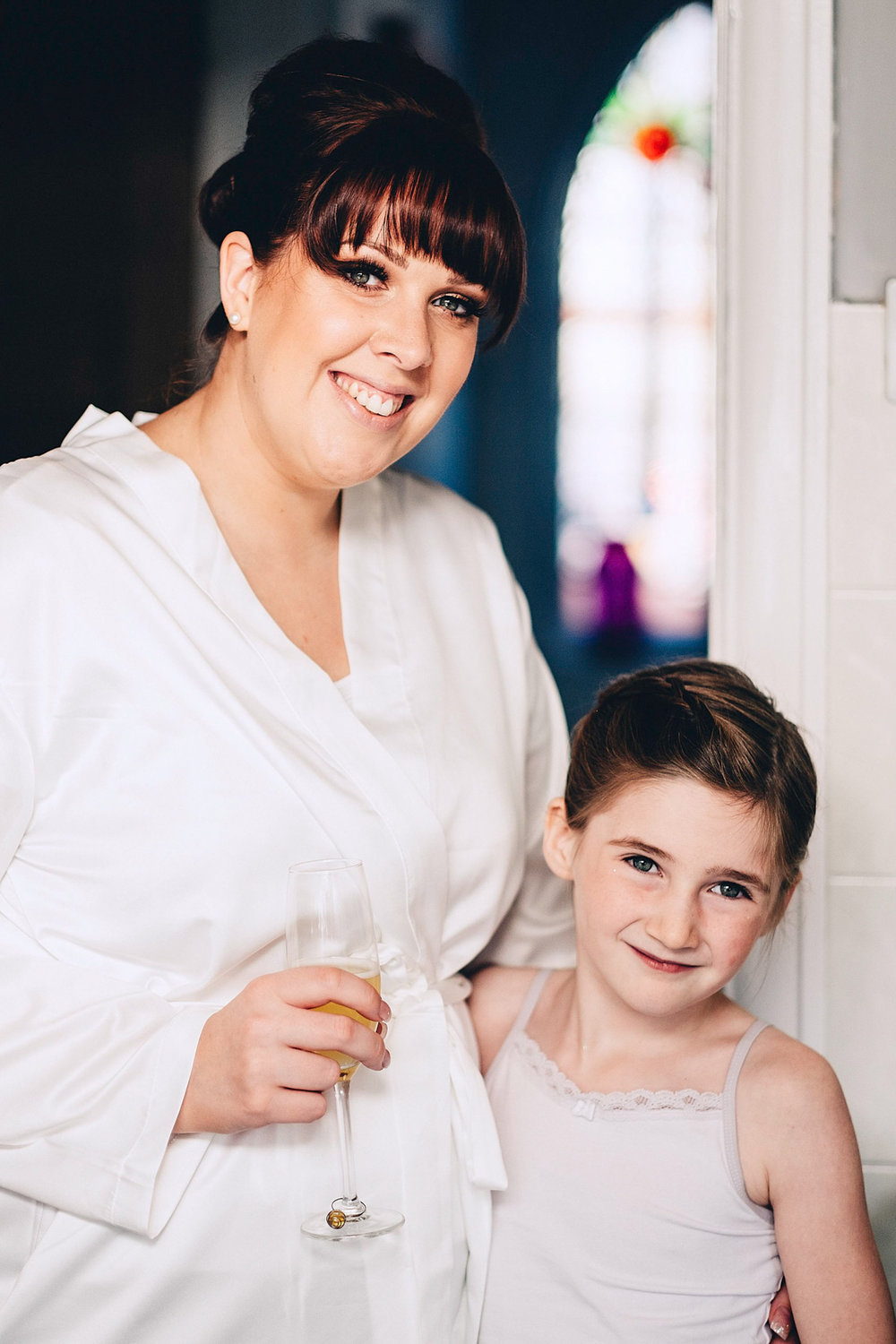 Bride and daughter pose for photo