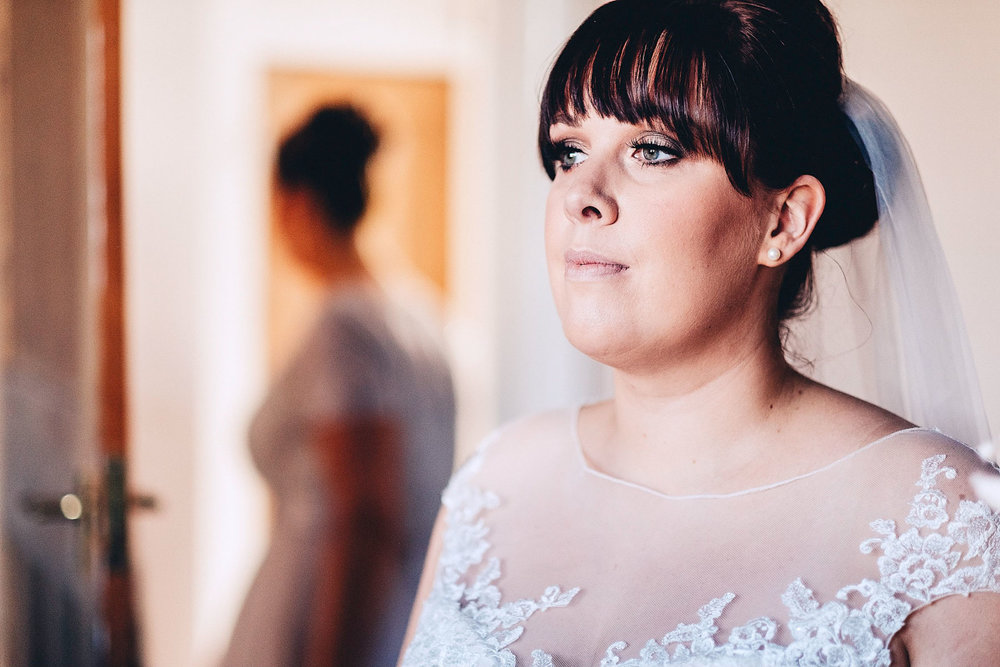 Bride looks on thoughtfully