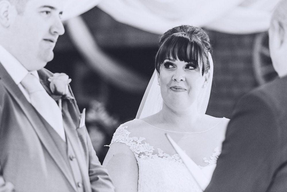 Bride looks lovingly at partner