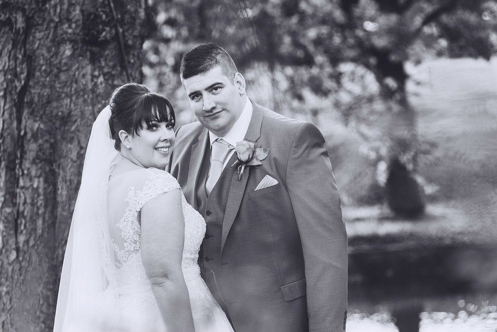 Black and white picture of Bride and Groom staring at the camera