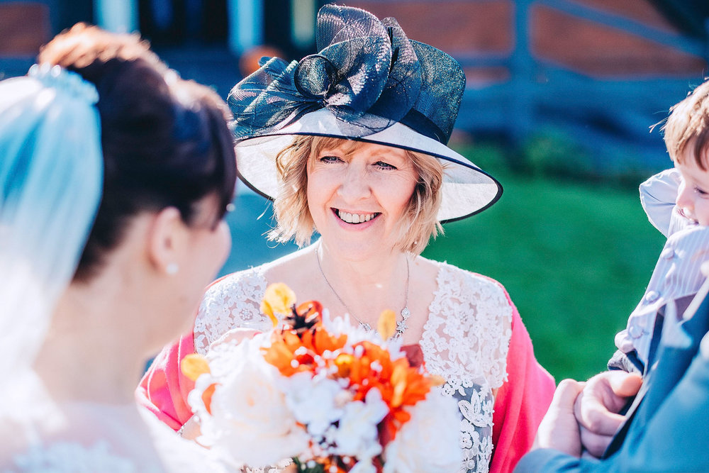 Mother of the Bride smiles at daughter