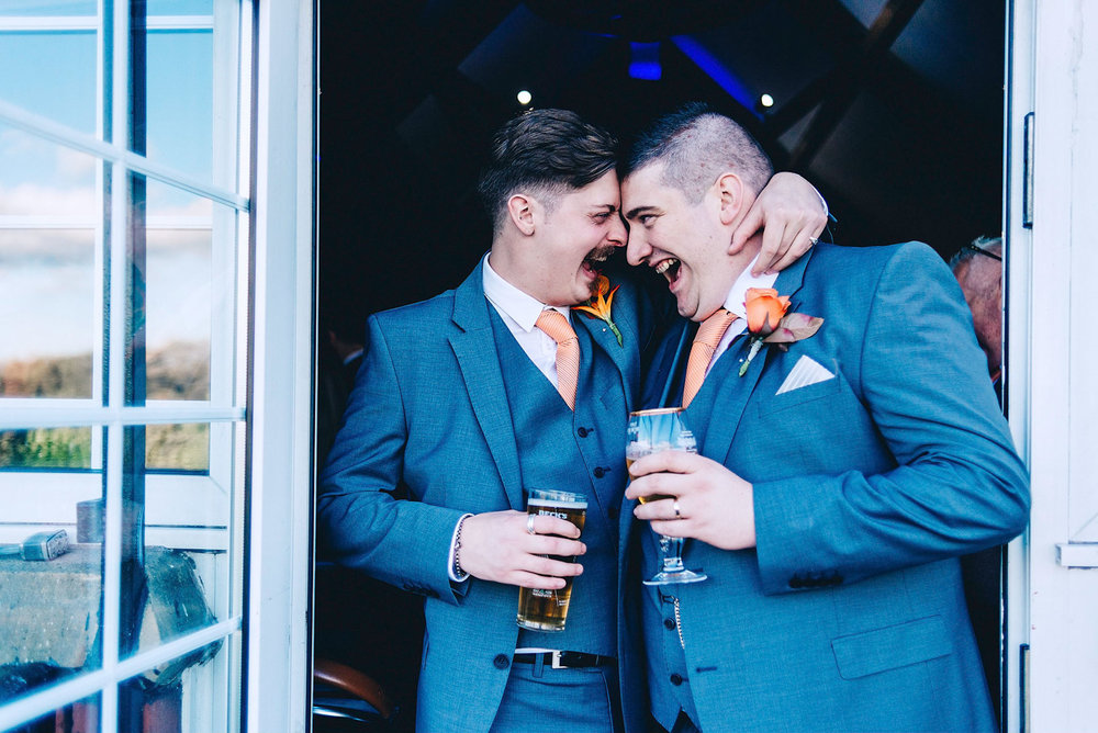 Groom and Best man share joke