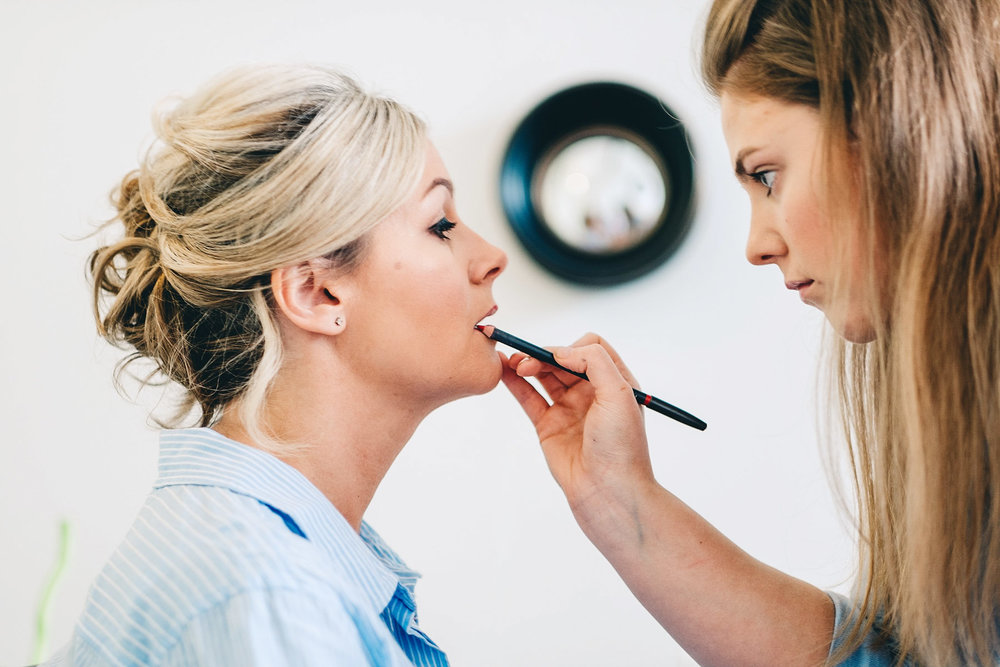 Make-up being applied to bridesmaid