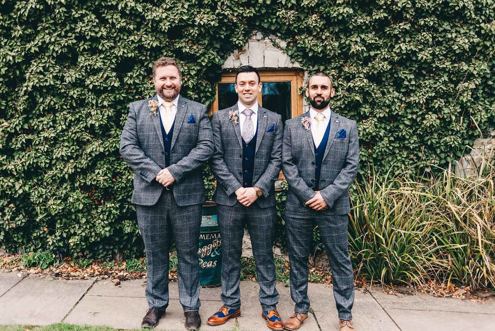 Groom and groomsmen pose for photo in Rosedew Farm Llantwit Major