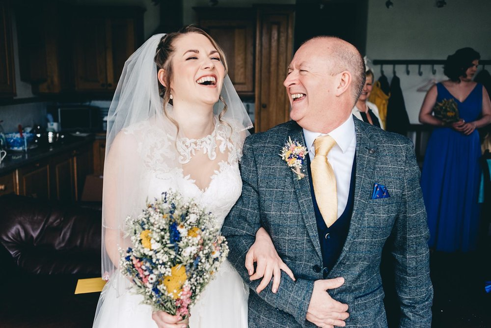 Bride laughs with father