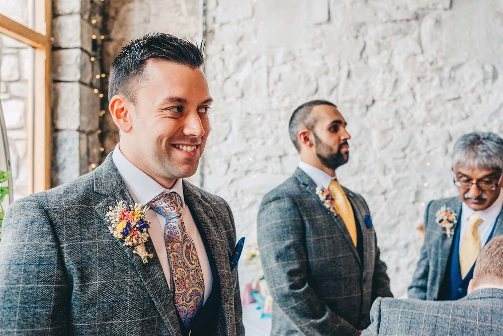 Groom smiles when wedding starts