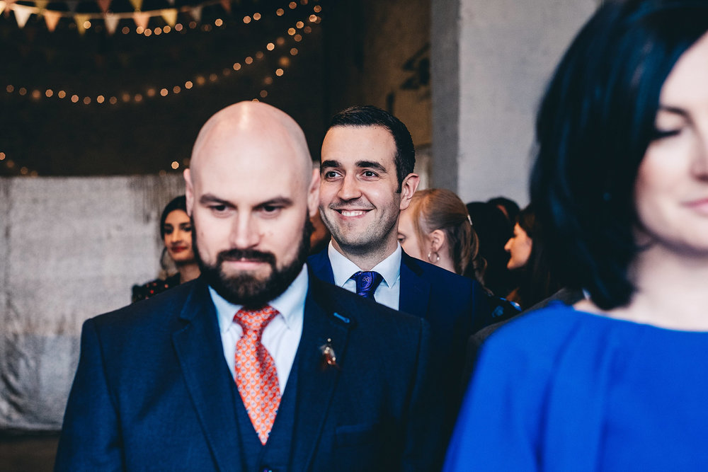 Guest smiles when service starts at wedding