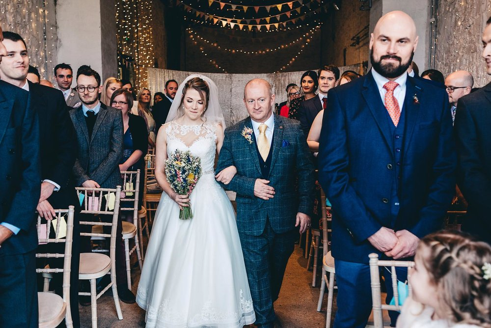 Beautiful bride walks down the aisle during a wedding