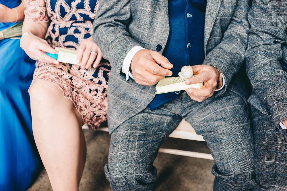 Guests open treats during wedding service