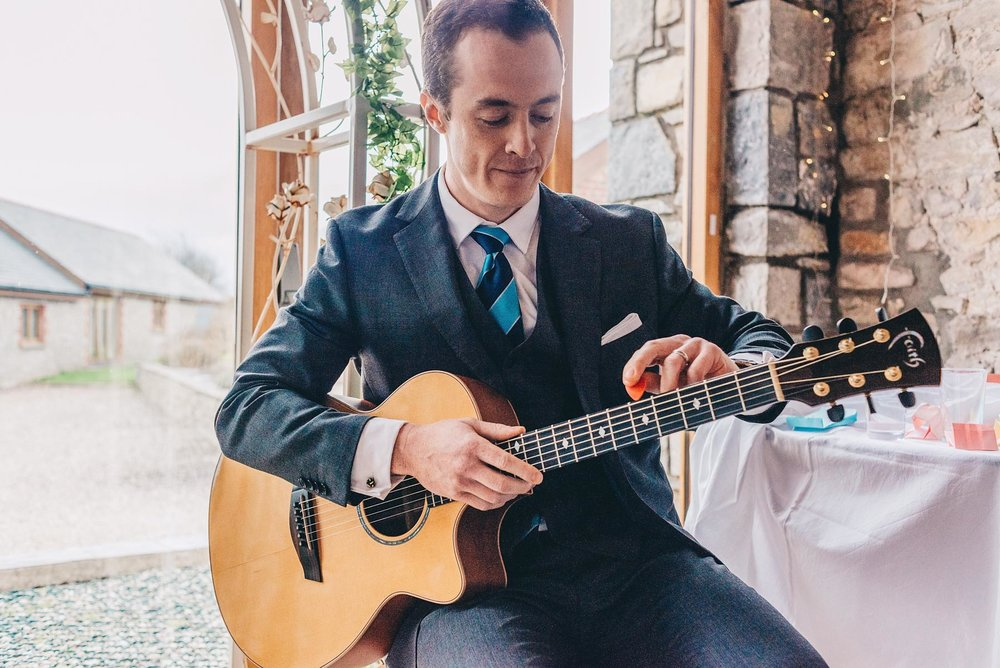 Man plays guitar during wedding service