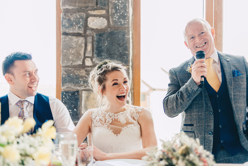 Bride laughs as Father of the Bride gives his speech