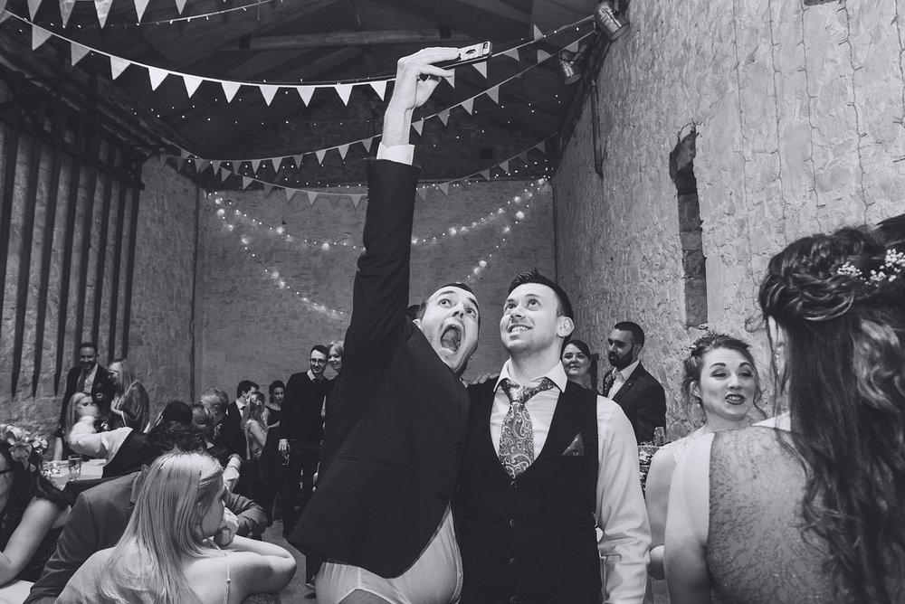 People take a selfie at wedding