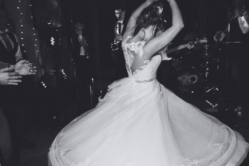 Bride spins round during the wedding dance