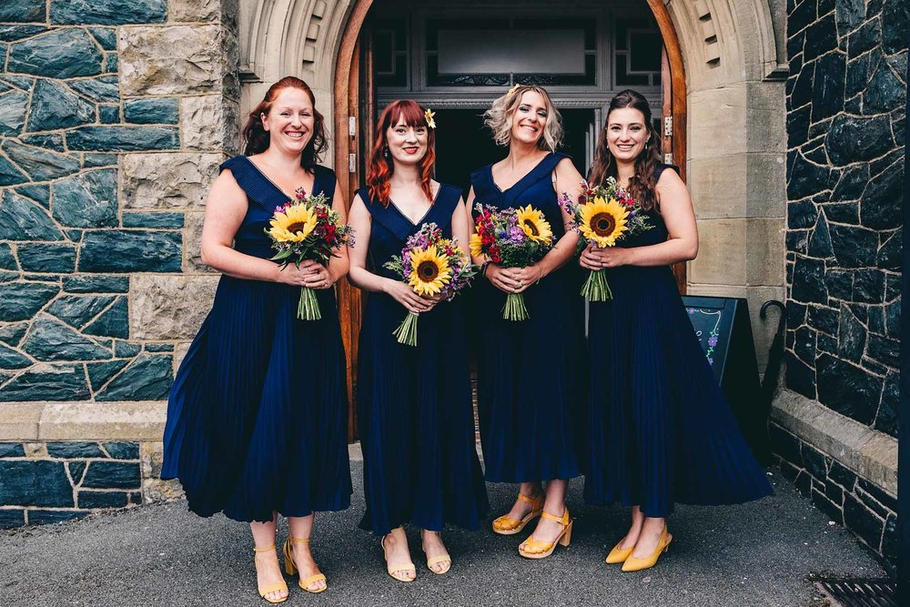 Bridesmaids pose outside the Prichard Jones Institute