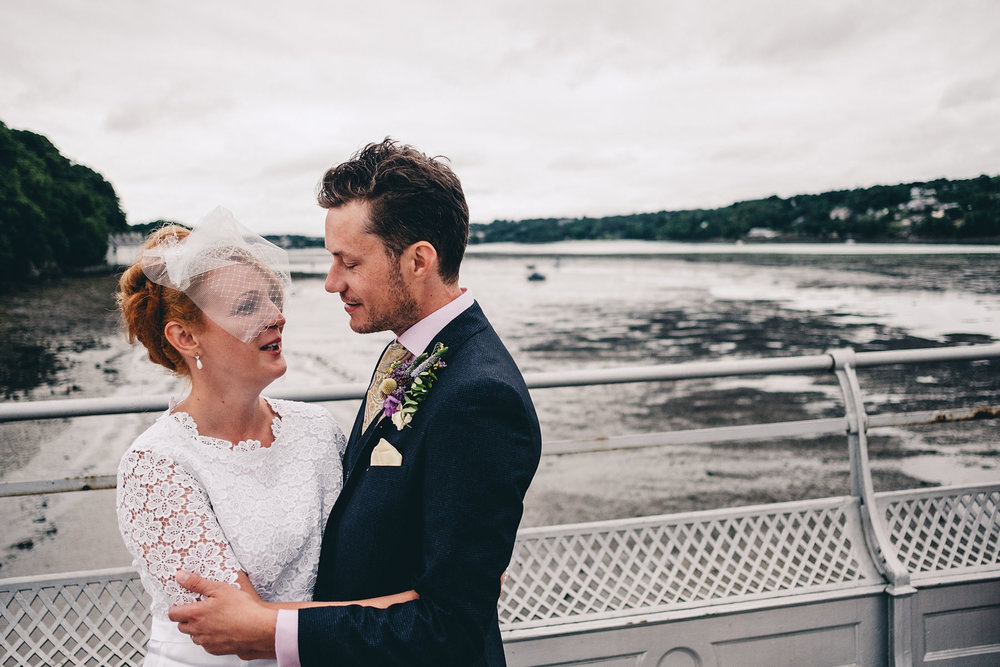 Bride and groom pose at Bangor Garth Pier North Wales