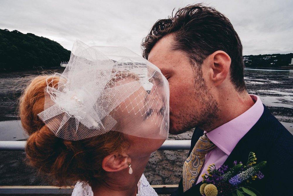 Bride and groom kiss on Bangor Garth Pier