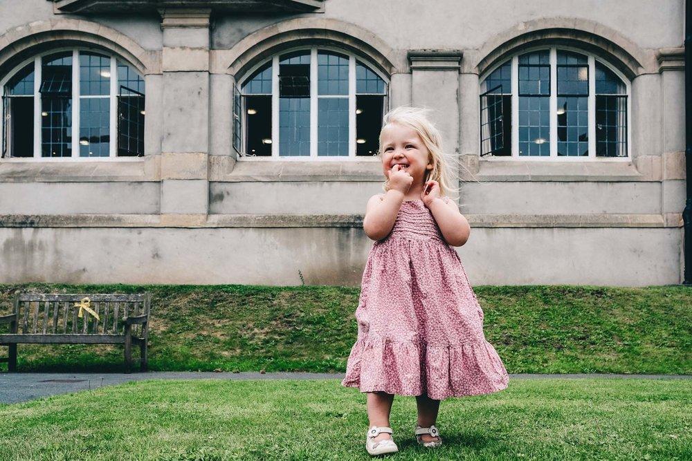 Girl smiles outside Hugh Owens Hall