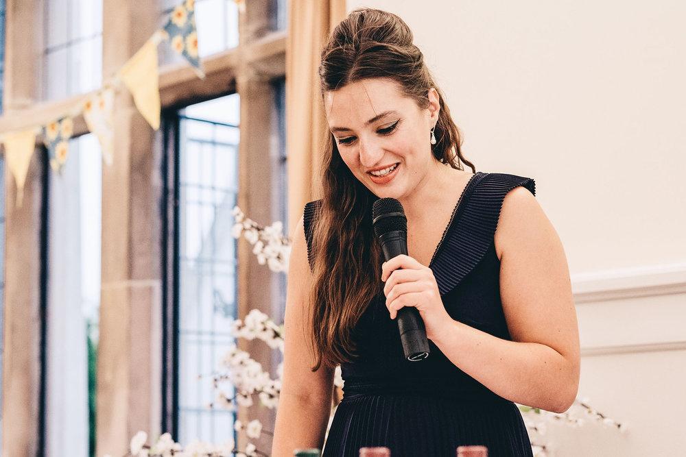 Bridesmaid gives speech at wedding