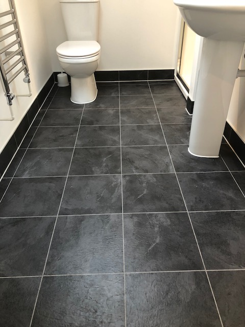 Slate effect Luxury vinyl tile with grout strip.