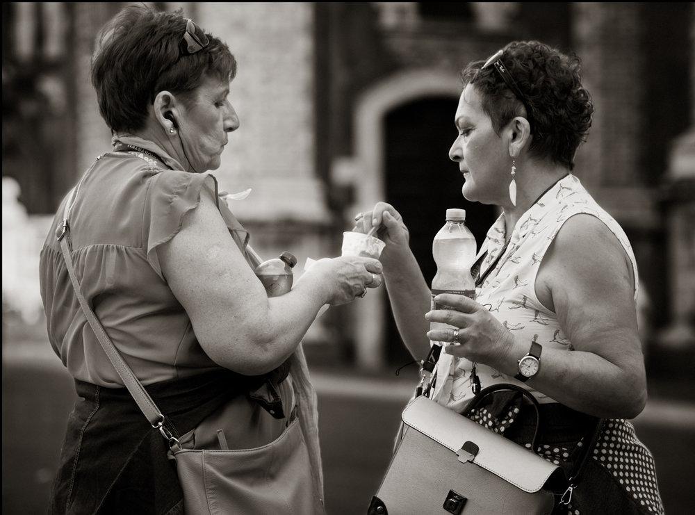 Enjoying one icecream together...