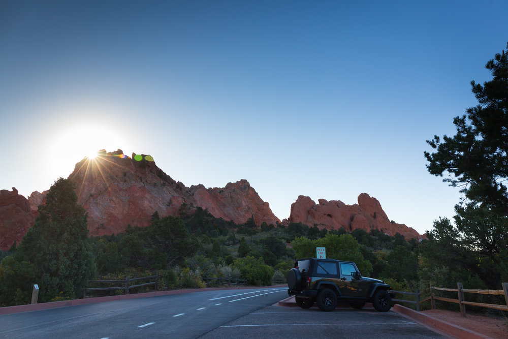 The sun rising over the red rocks on a crisp, early autumn morning