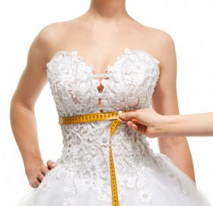 bride-getting-measured-for-her-bridal-gown.jpg