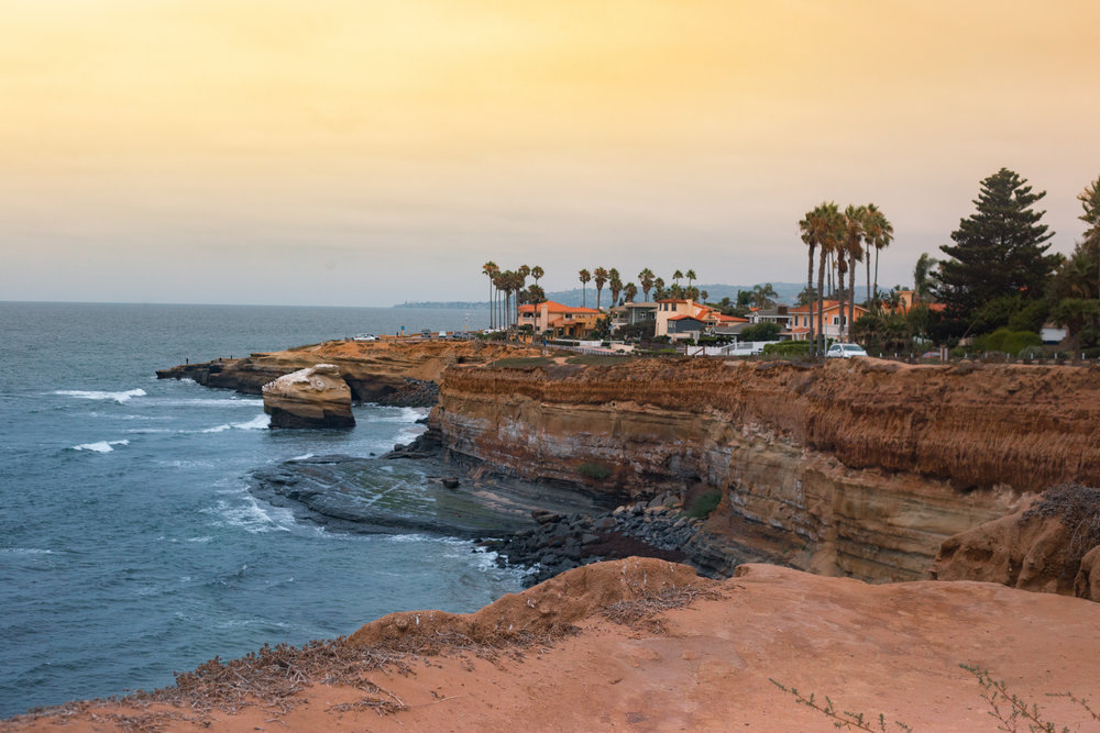 Sunset Cliffs - San Diego, CA   Taken while on tour with in Your Memory. We had two shows and two off days in Southern California. We had pretty opposing interests and priorities at times on this run, but everyone agreed that going to Sunset Cliffs would be something fun to do and provide great content. It was actually incredibly overcast that day, but I beefed up few things in post and fell in love with this shot even more.