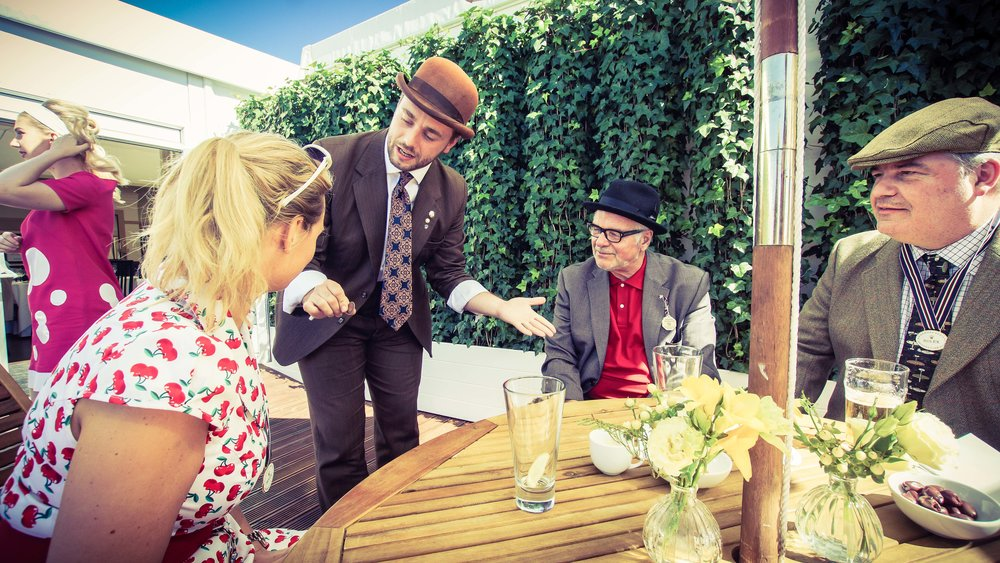 Corporate entertainer Nick Stein performing Close up magic in Goodwood hospitality for Rolex