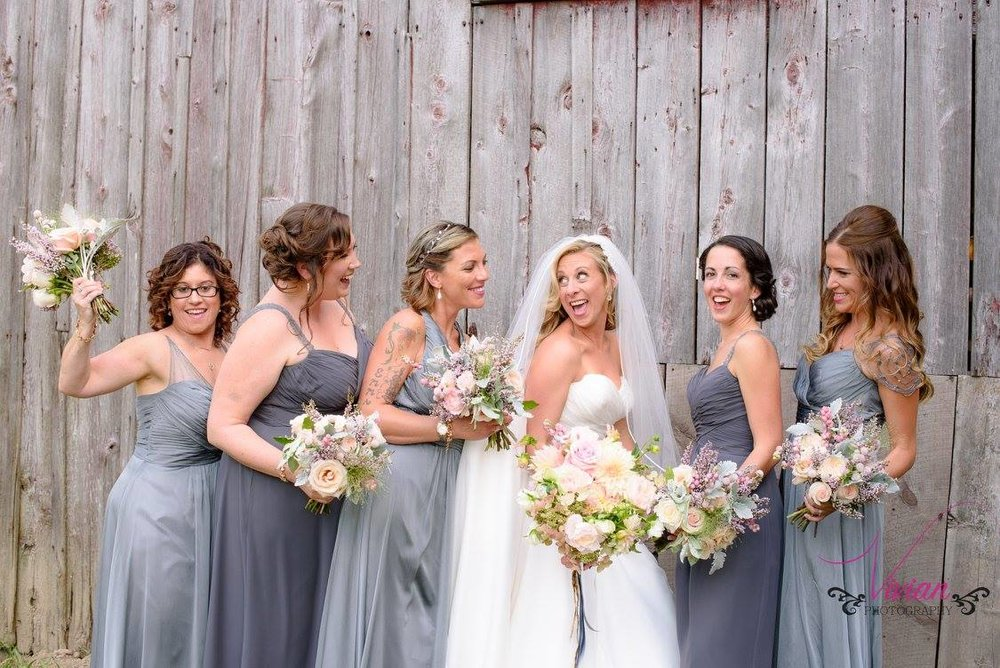 bridesmaids-posing-with-bride-on-wedding-day.jpg