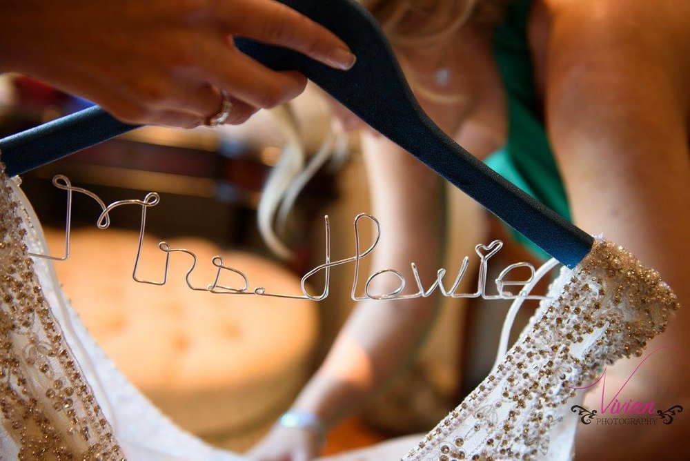 custom-wedding-hanger-with-grooms-last-name-made-out-of-the-wiring.jpg