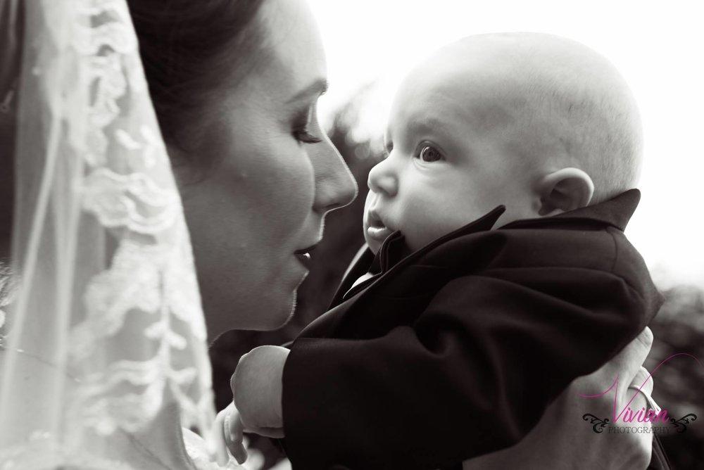 bride-kissing-baby-close-up.jpg