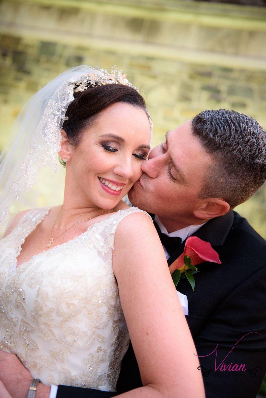 groom-kissing-bride-from-behind.jpg