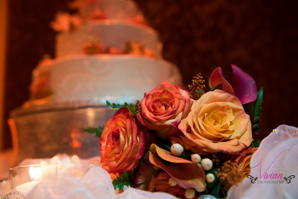 wedding-cake-in-background-bouquet-in-forefront.jpg