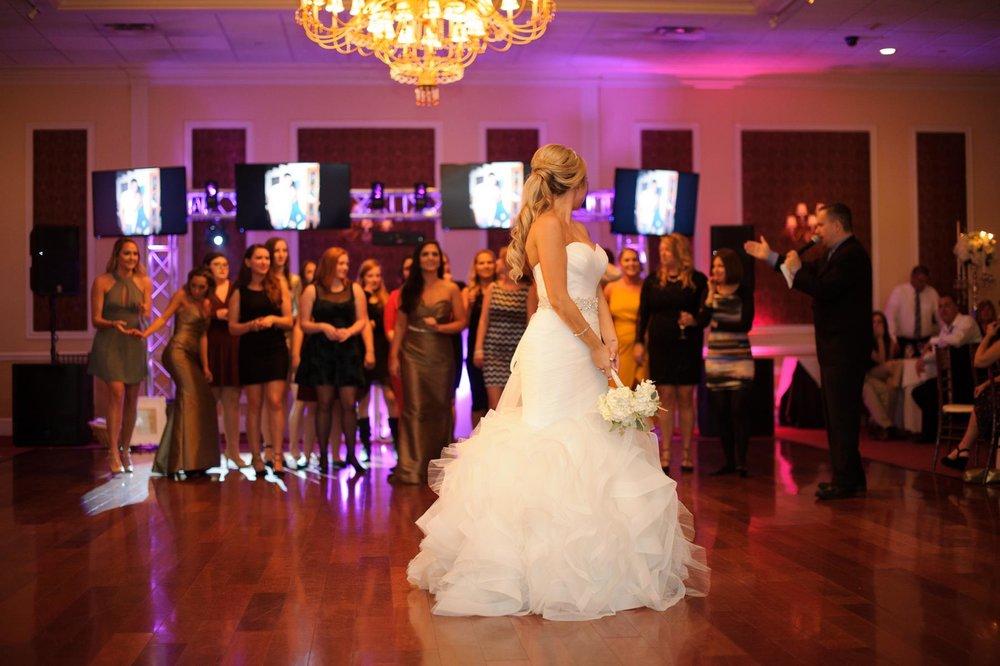 bride-preparing-to-throw-bouquet.jpg