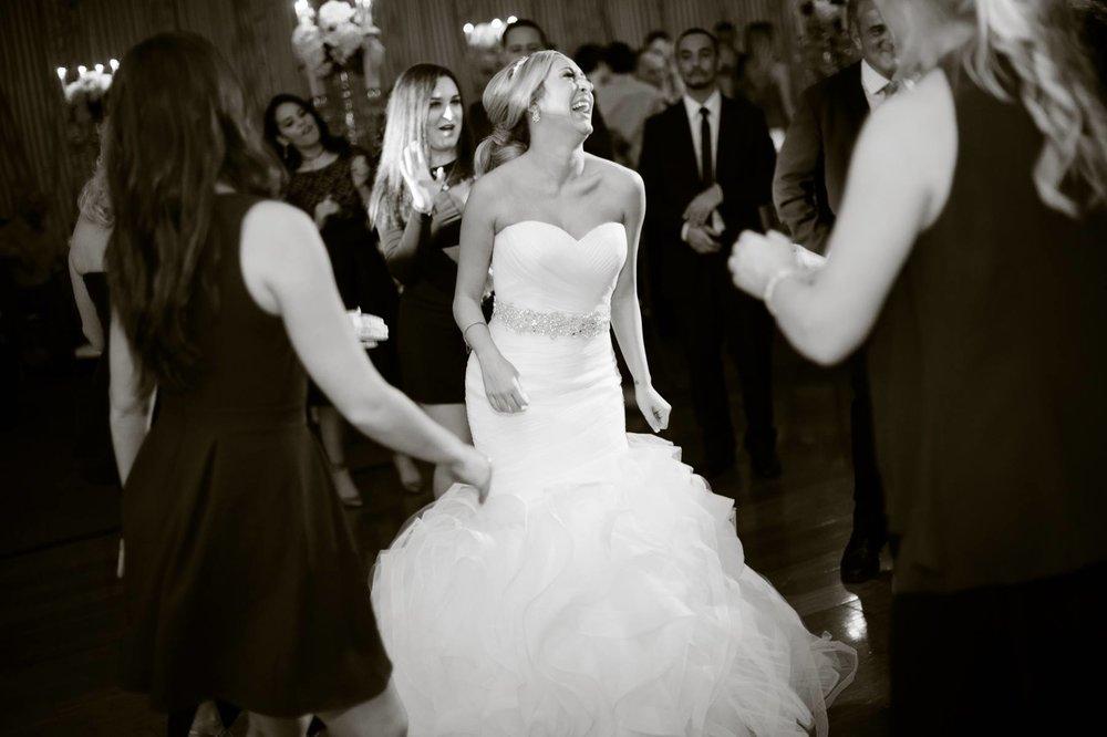 bride-dancing-candidly-on-dance-floor.jpg