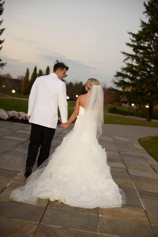 bride-and-groom-walking-away.jpg
