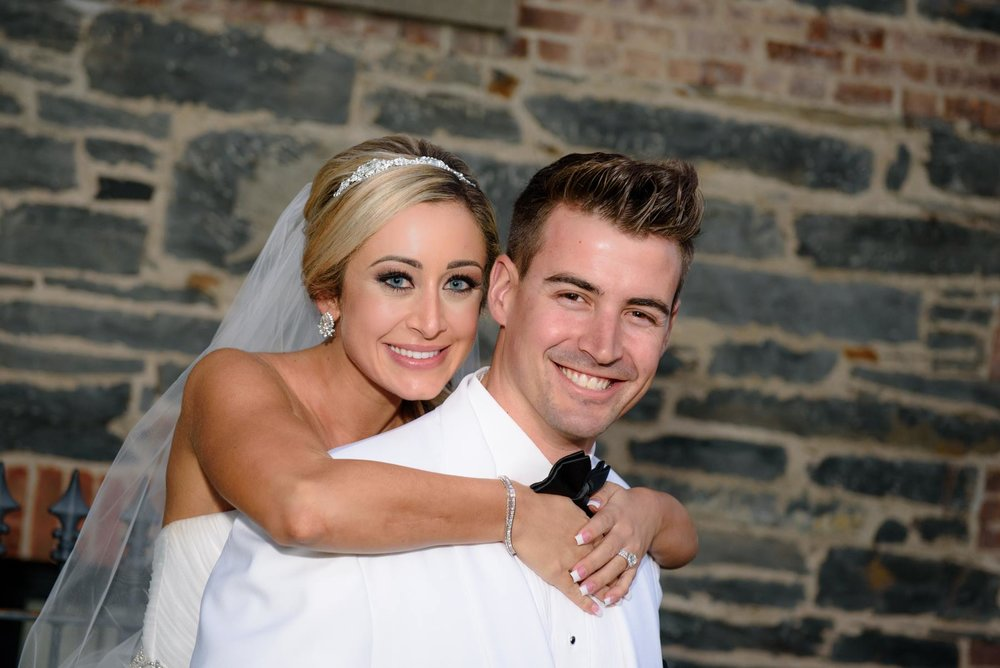 bride-posing-behind-groom.jpg