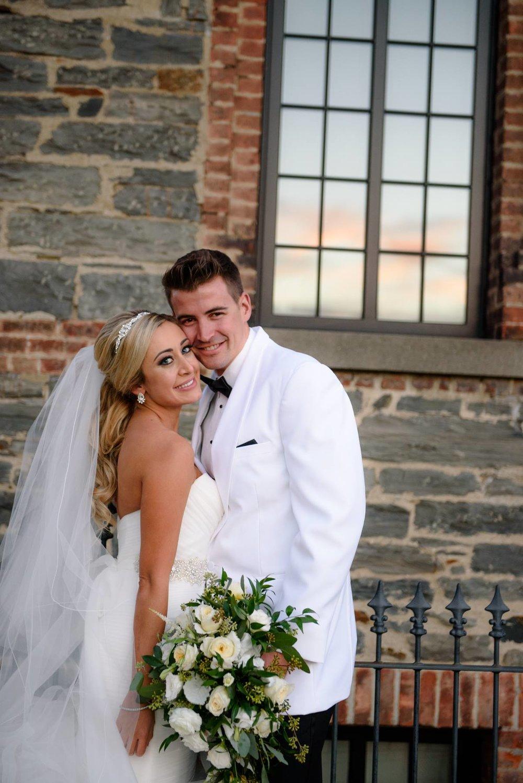 wedding-couple-posing-front-of-church.jpg