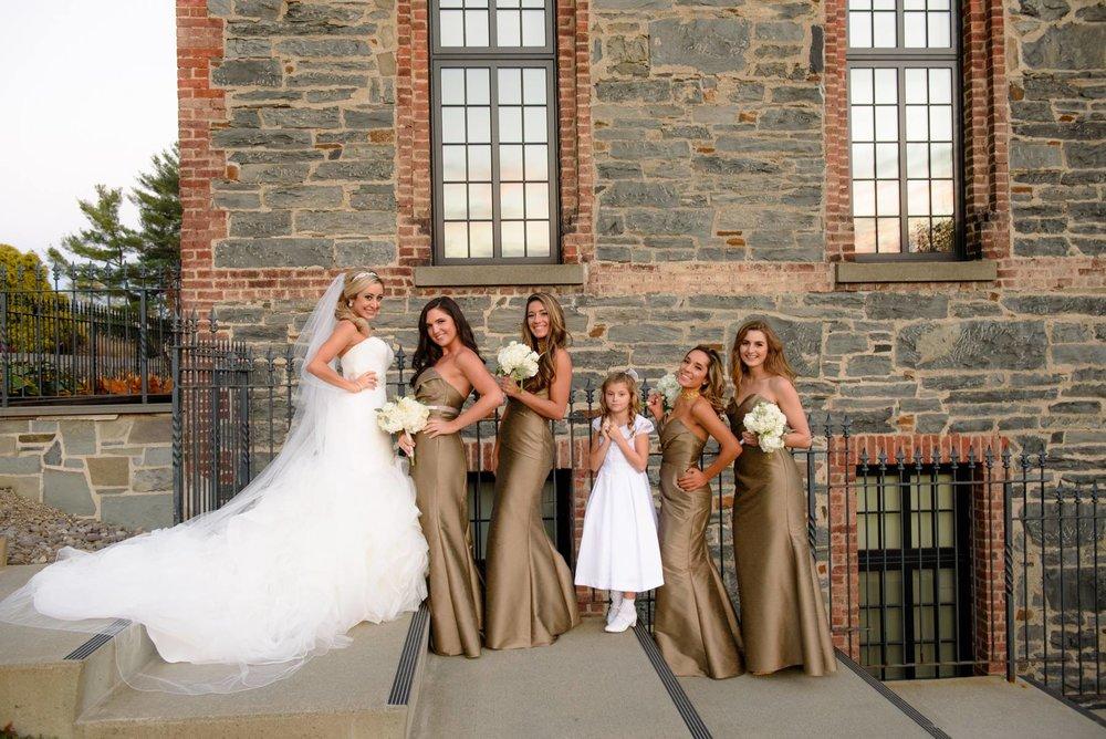 bride-posing-with-bridesmaids.jpg