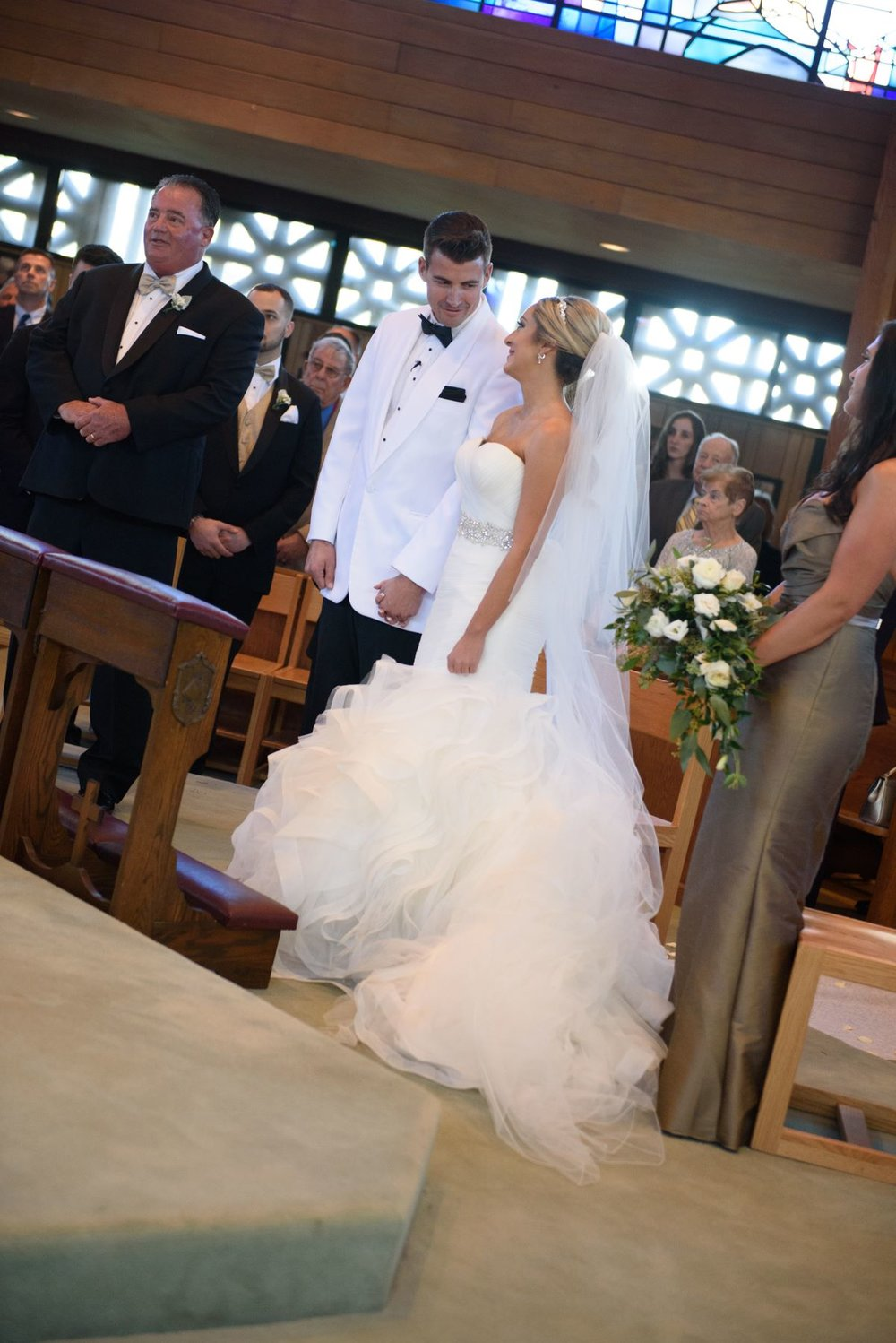 bride-and-groom-staring-each-other-church.jpg