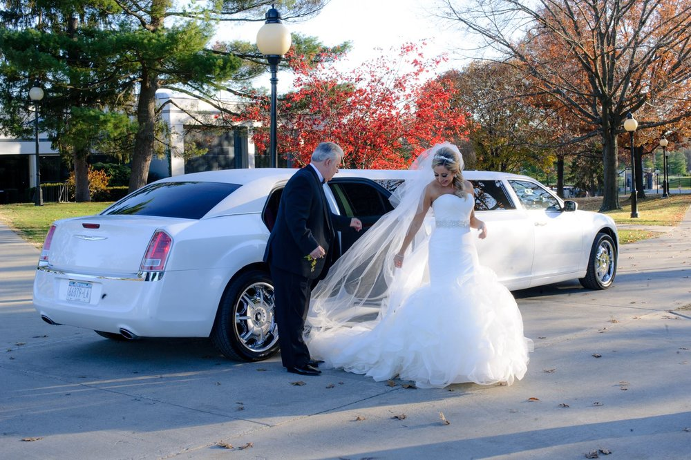 bride-and-father-stepping-out-of-limo.jpg