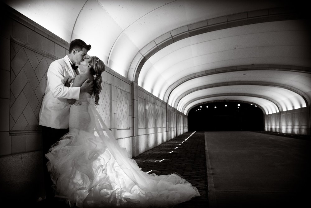 bride-and-groom-kissing-in-tunnel.jpg