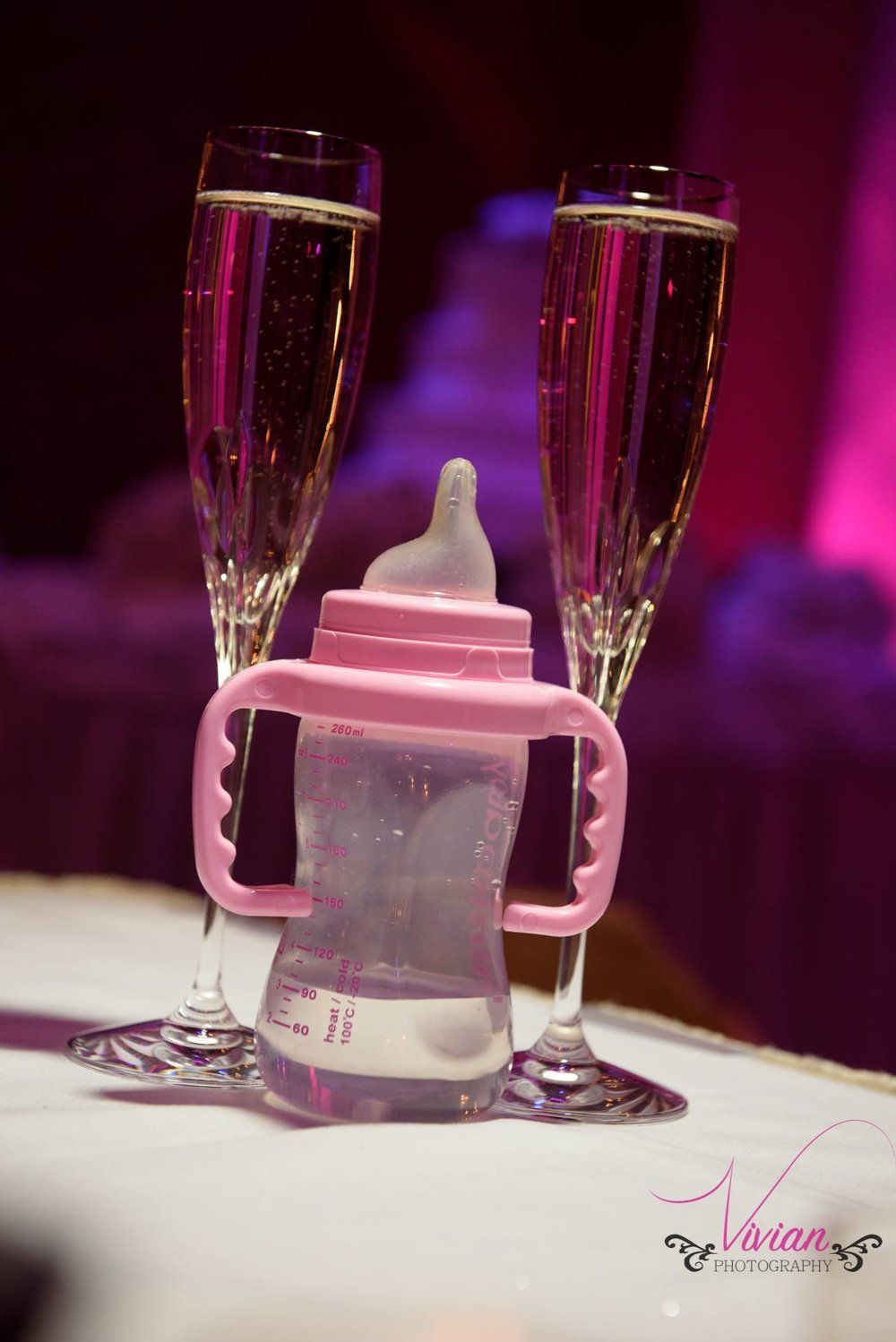 champagne-glasses-with-baby-bottle-between.jpg