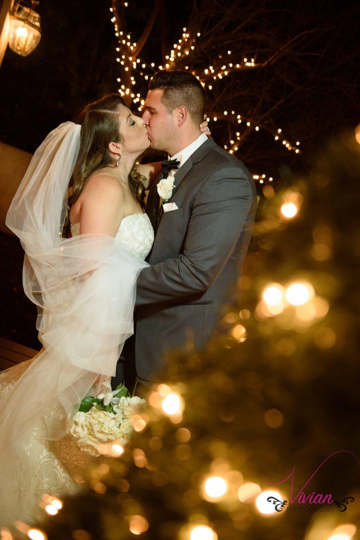 bride-groom-kissing-in-christmas-lights.jpg
