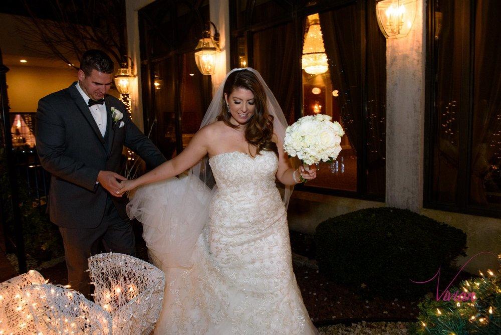 bride-leading-groom-by-hand-christmas-lights.jpg
