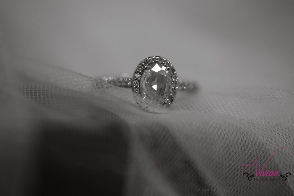 close-up-oval-wedding-ring-resting-in-tulle.jpg