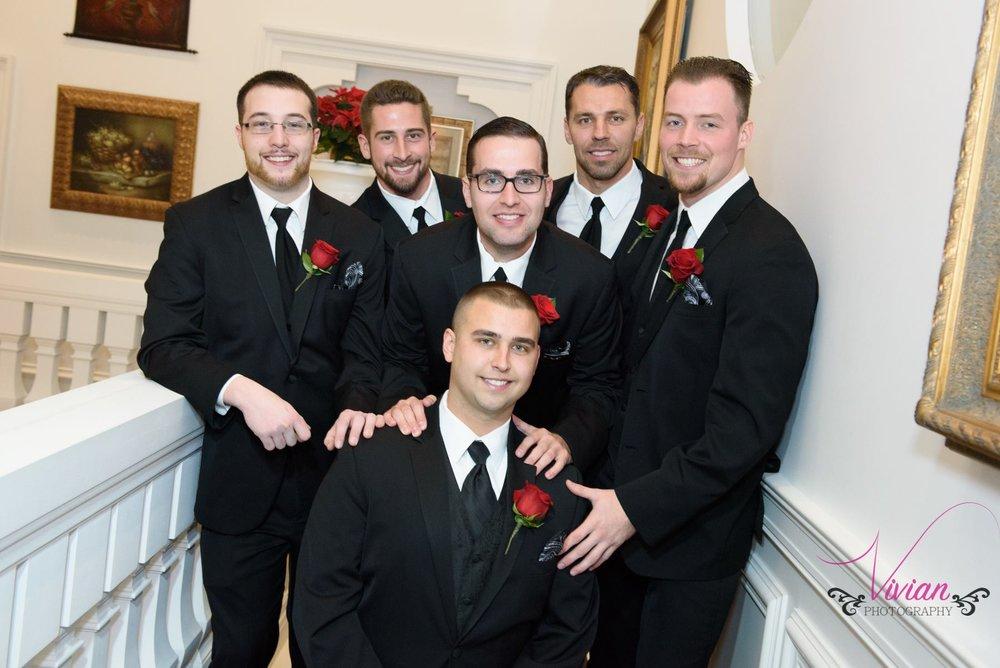 bride-posing-with-groomsmen.jpg