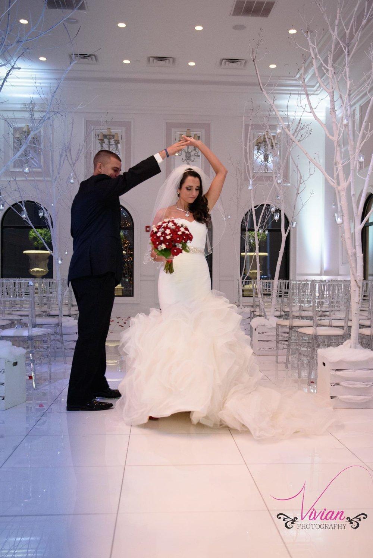 groom-twirling-bride-in-winter-wonderland-theme-wedding.jpg
