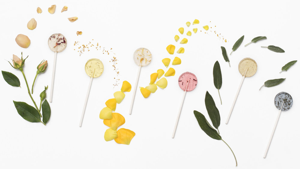 """In keeping with earth-friendly approach, each of the lollipops is based in botanics, with plant-centered flavors like ""peach & marigold"" and ""lavender & lemongrass"", which are appealing to children and adults alike. (If you're not convinced, know that Amborella Organics is partnering with top lingerie brand La Perla to serve their champagne & roses lollipops at a Women's Day fundraising event.) The pairings are sophisticated, a boon to grown-ups (who may enjoy lollipops but don't want to eat blue raspberry) and a way to expand children's palettes."" Read on by clicking on the image above."
